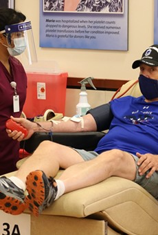 A donor gives blood at a South Texas Blood and Tissue Center site.