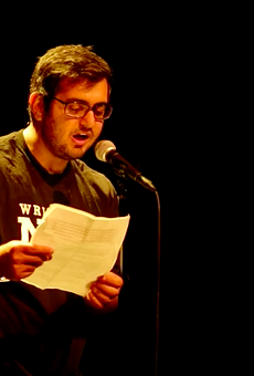 Amir Safi performing 'An Ode to Whataburger.'