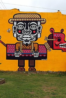 A mural by Mexican muralist Miguel Mejia (aka Neuzz) .