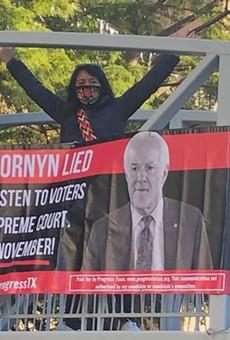 Progressive groups unfurl anti-John Cornyn banner along San Antonio River Walk