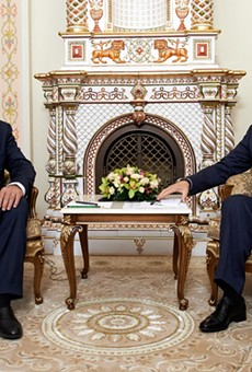 Israeli Prime Minister Benjamin Netanyahu sits with Russian President Vladimir Putin.