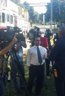 SAFD Chief Charles Hood addresses media near the drainage ditch by Babcock and Fredericksburg roads where a 41-year-old man was swept away.
