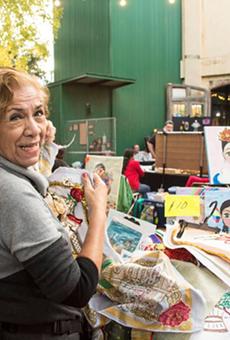 A vendor at a past edition of the Esperanza Center's Mercado de Paz.