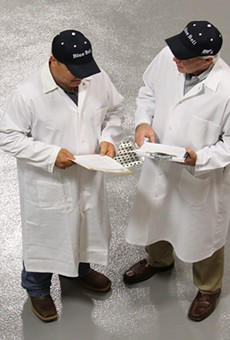 Two Blue Bell employees work on enhancements to the process at one of the company's facilities in this June, 2015 photo.