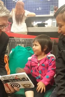 Immigration officials dropped this woman and her child off at a Greyhound station last March. RAICES visited the facility with this clergy member to hand care backpacks to mothers and children heading to all corners of the country after being released from detention facilities.