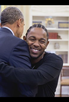 Lamar and Obama exchange thoughts and hugs in the Oval Office