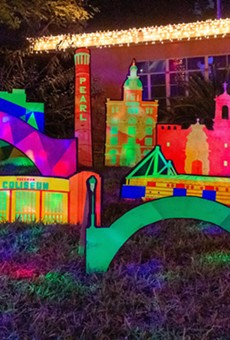 The fluorescent holiday decor features San Antonio landmarks including Freeman Coliseum and La Torcha de Amistad.