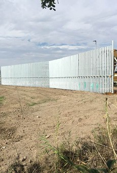 A section of wall being erected near the National Butterfly Center in South Texas.