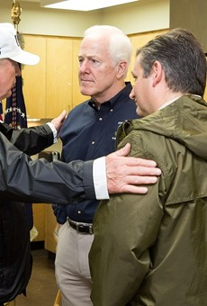Donald Trump clasps the shoulders of Republican Senators from Texas John Cornyn (middle) and Ted Cruz (right).