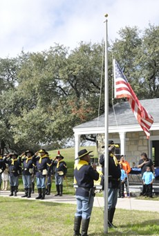 106 Buffalo Soldiers living historians raise the flag at the Institute of Texan Cultures Back 40