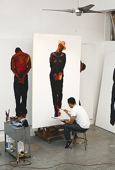 Vincent Valdez in the studio, working on 'The Strangest Fruit', 2013, which explores the history of lynchings of Mexicans in the Southwest.