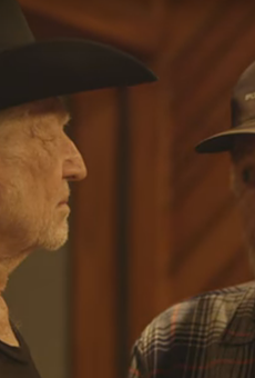 "Willie Nelson and Merle Haggard in their recent video for ""It's All Going to Pot."""