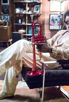 Don Cheadle as jazz trumpeter Miles Davis.