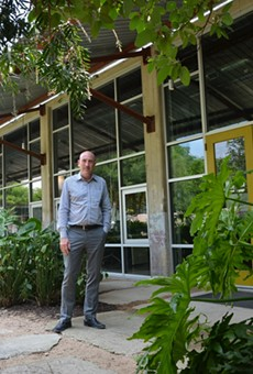 Irby Hightower, founding principal at Alamo Architects, stands outside of the firm's Southtown headquarters.