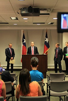 Texas Attorney General Ken Paxton speaks at a press conference announcing he has filed yet another lawsuit against the federal government.