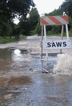 Sewage flows out of a manhole on Holbrook Road.