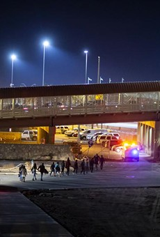 U.S. Customs and Border Protection agents escorted a group of migrants near the Paso del Norte International Bridge in El Paso in 2019.