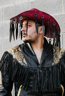 El Paso-based photographer Jeanette Nevarez captured Villalobos in a hat he hopes to use in a future performance.