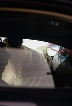 A nurse conducts a swab test for COVID-19 on a patient in a drive-thru station at the Austin Emergency Center at Mueller on Jan. 25, 2021. Since the fall, the CDC says there have been several new variants identified worldwide: A UK variant (B.1.1.7), a South African variant (B1.351) and a Brazilian variant (P.1).