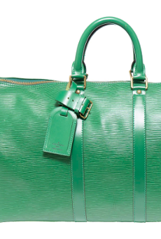 This Louis Vuitton travel bag is among the items being auction off to pay restitution to investors the feds say businessman Brian Alfaro defrauded.