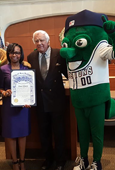 Mayor Ivy Taylor poses with San Antonio Missions owner David Elmore and mascots Ballapeno and Henry the Puffy Taco