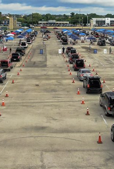 Cars line up for an emergency food distribution in San Antonio.