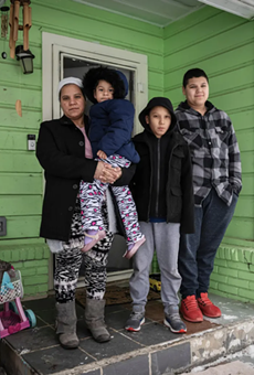 Marleny Almendarez, 38, with her niece Madelyne Hernandez, 3, and two boys, Aaron Hall, 11, and Matthew Hall, 14, outside their home in Dallas on Feb. 18, 2021. The family spent two nights at a mobile warming station to avoid the cold temperatures.