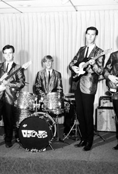 The Outcasts smile for the camera in a mid-'60s promotional photograph.