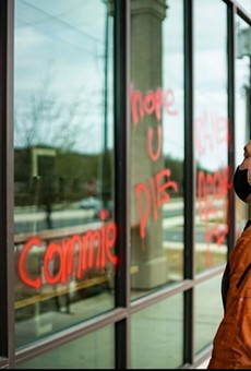 Noodle Tree owner Mike Nguyen surveys the vandalism to his restaurant on Sunday.