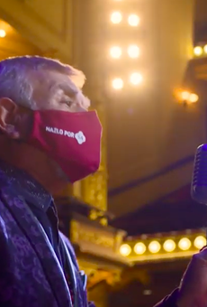Tejano singer Little Joe delivers his message with a mask on.