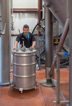 Head brewer Gregg Spickler moves fermentation tanks which yield CO2 naturally as a byproduct of beer making.