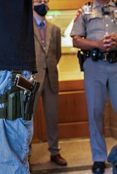 Two gun rights activists argue with a state trooper who will not allow them to enter an overflow room due to COVID-related restrictions at the Capitol on April 29, 2021.