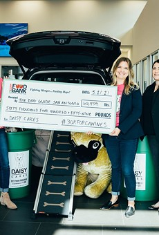 The Dog Guide San Antonio donated over 60,000 pounds dog food to DaisyCares.
