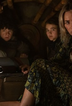 """Evelyn (Emily Blunt, far right) and her children, from left, Marcus and Regan, hide inside a furnace to avoid alien attackers in """"A Quiet Place Part II"""""""