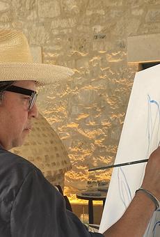 Cruz Ortiz paints 2021 Rey Feo Thomas Aguillon.