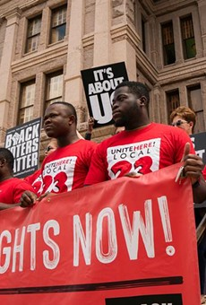Individuals stand on the south steps of the Texas Capitol in support of voting rights at a press conference organized by Black Voters Matter, the Texas Right to Vote Coalition, Texas for All Coalition and other advocacy groups on July 8, 2021.