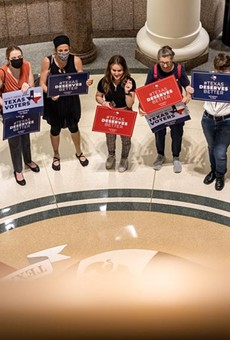 Activists gather outside a Senate committee hearing on proposed election reforms at the Capitol on Saturday, July 10, 2021.
