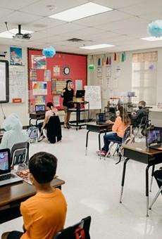 Plexiglass and 6 feet of space between each desk keep students socially distanced in Abigail Boyett's third grade classroom.
