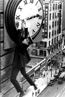 Harold Lloyd hangs from a clock on the side of a skyscraper in the most famous scene from Safety Last!