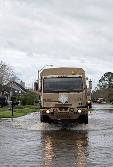 Louisiana National Guard members in high-water vehicles and boats work with St. John the Baptist Parish officials to rescue citizens stranded in their homes in the wake of Hurricane Ida.