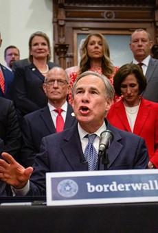 Flanked by Lt. Gov. Dan Patrick, left, and House Speaker Dade Phelan, Gov. Greg Abbott held a press conference at the Capitol on June. 16, 2021.