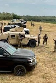 """Gov. Greg Abbott touted a cordon of DPS and military vehicles parked along a portion of the Texas border as a """"steel wall."""""""