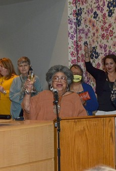UTSA Professor Emerita Ellen Riojas Clark raises a glass to the late Gregg Barrios.