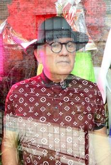 San Antonio designer Agosto Cuellar in the window of his Blue Star boutique Augustine.