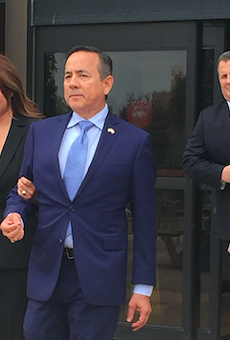 Sen. Carlos Uresti leaves San Antonio's federal courthouse after being indicted on fraud and bribery charges.