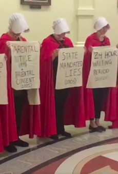 Women dressed like characters from The Handmaid's Tale protesting anti-abortion bills at the Texas state capitol.