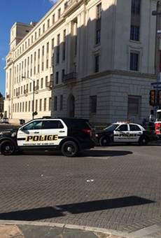 Police swarmed around the federal building downtown Wednesday afternoon