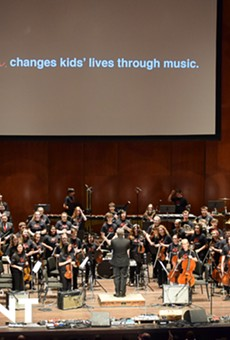 YOSA Philharmonic, led by Director Troy Peters, performing at the YOSA Presents 'Abbey Road' concert.