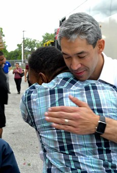 Mayor Ron Nirenberg hugs a Hurricane Harvey evacuee on Saturday.