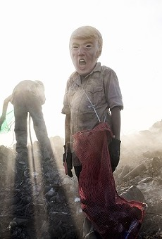 """""""a young potential trump collecting cans in a landfill"""""""